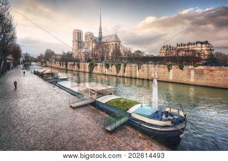 Quai de Montebello and Cathedrale Notre-Dame de Paris on Ile de la Cite. France. Paris