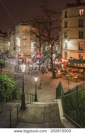 Crossroads rue Maurice Utrillo, rue Paul Albert, rue Feutrier and rue Muller. Paris. France