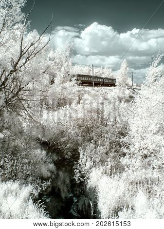 Infrared photography. The Vokhonka River and the railway