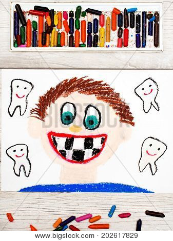 Photo of colorful drawing: Smiling boy without milk teeth. Losing baby teeth.