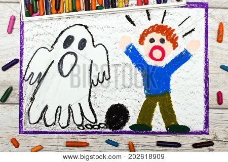 Photo of colorful drawing: Scary ghost with chains and scared little boy