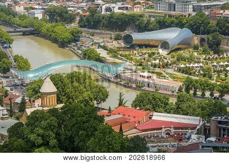 Tbilisi, Georgia - Juny 6, 2017: view of the modern symbols of Tbilisi : New Cultural Center, Rike park, pedestrian Bridge of Peace and Presidential Palace, Georgia on May 6, 2017