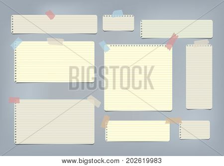 Yellow striped, ruled note, copybook, notebook paper stuck with sticky tape on blue background