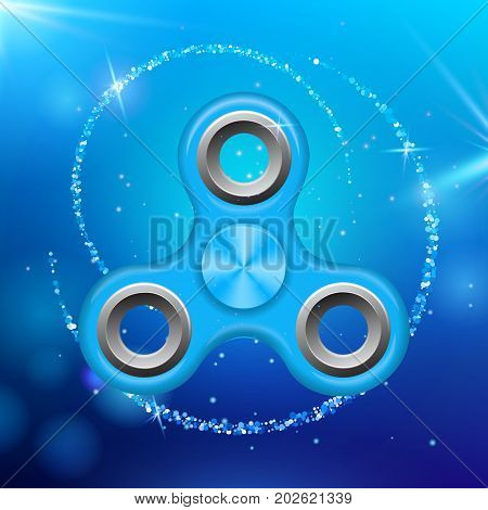 Blue colorful spinner on an abstract background with blue luminous backdrop. Abstract background with blue luminous backdrop. Modern children's blue toy - spinner.