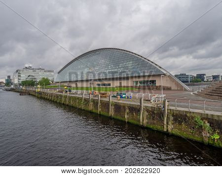 GLASGOW SCOTLAND - JULY 22: The Glasgow Science Centre along the River Clyde on July 22, 2017 in Glasgow Scotland. The Science Centre is a popular Glasgow attraction.