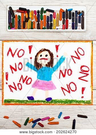 Photo of colorful drawing: Little girl screaming the word NO