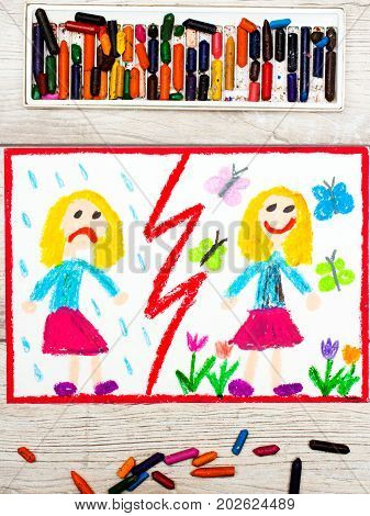 Photo of colorful drawing. Opposites: sad and happy girl
