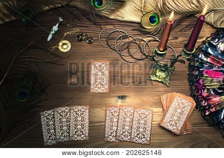 Tarot cards on wooden table. Fortune teller.