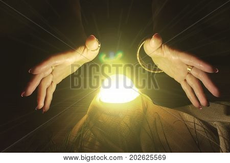 Crystal ball and fortune teller hands. Divination. Seance.