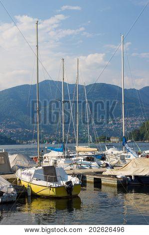 Boats and masts on the lake Como