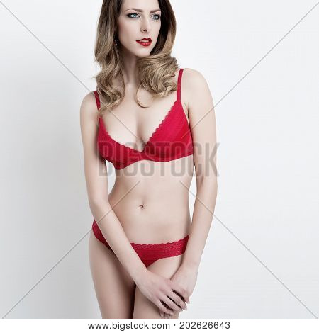 sexy slim beauty model girl in red lingerie