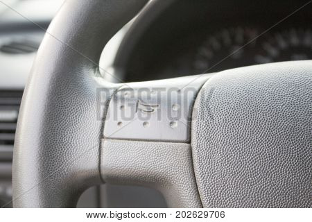 A car's horn button on the steering wheel. Mark of horn on the steering wheel  in an old car