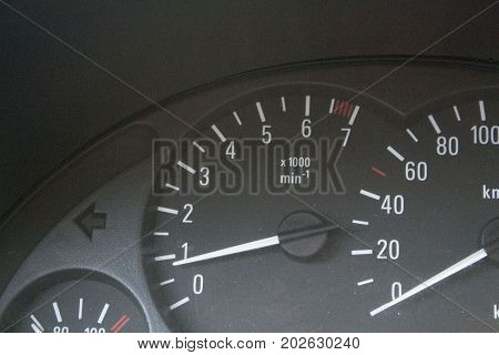 Dashboard inside the car. speedo, turnovers and  tachometer on the panel of old car indoors.