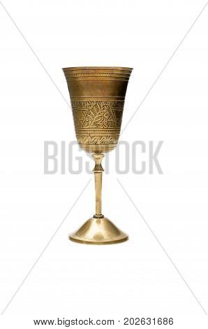 Goblet isolated on white background. Old vintage brass goblet.