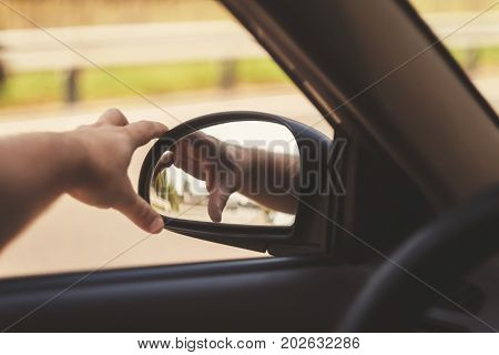 Man's Hand Corrects The Side Mirror In The Car, Retro Toning