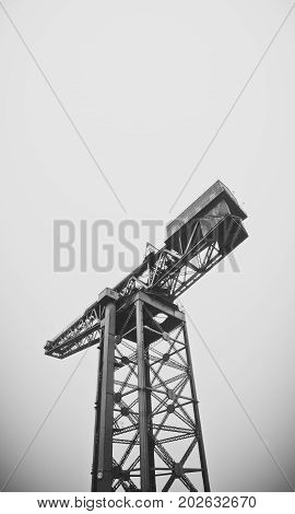 Industrial Shipbuilding Crane Against A Grey Sky With Copy Space