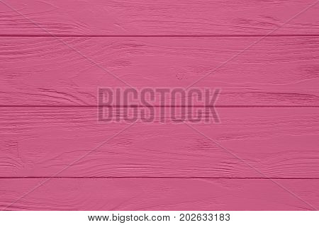 Wooden surface. Pink painted wood board texture and background. Pink natural wooden background. Aged wood planks pattern. Painted pink wood board texture background. Horizontal timber texture. Pink wood barn. Pink color wood barn. Wood board background. P