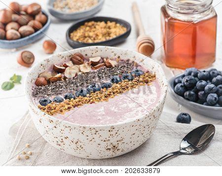 Healthy breakfast. Buckwheat Porridge. Raw buckwheat vegan breakfast smoothie bowl with fresh blueberries, nuts, chia seeds and bee pollen. Clean eating, dieting, detox, vegetarian food concept