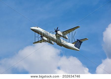 MONTREAL CANADA - AUGUST 28 2017 : Porter Airlines taking off plane. Porter Airlines is a regional airline headquartered at Billy Bishop Toronto City Airport on the Toronto Islands in Toronto