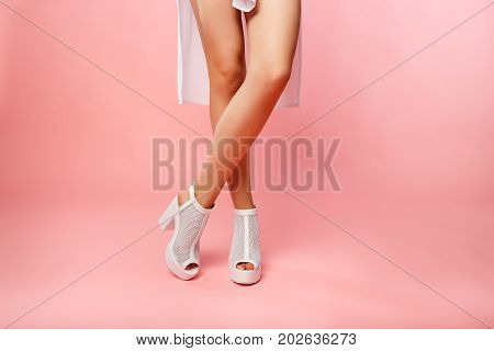 Beautiful Legs in white shoes to beautiful girl