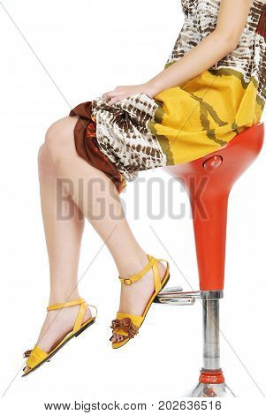 Beautiful skin women sitting on the bar chair with crossed legs