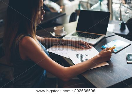 Time To Work Hard. Close-up Of Beautiful Woman Using Computer And Writing A New Special Project Whil