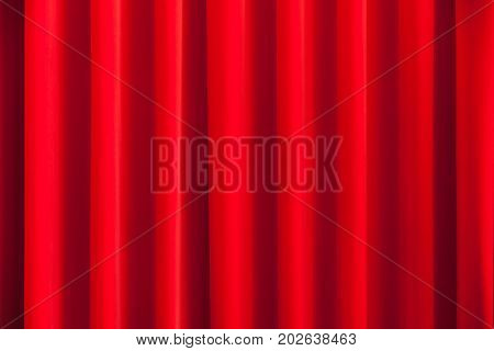 Red theatrical curtain, abstract background photo texture