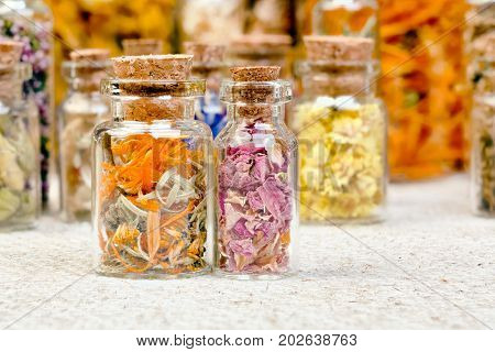 Bottles with herbs used in non- traditional medicine. High resolution photo.
