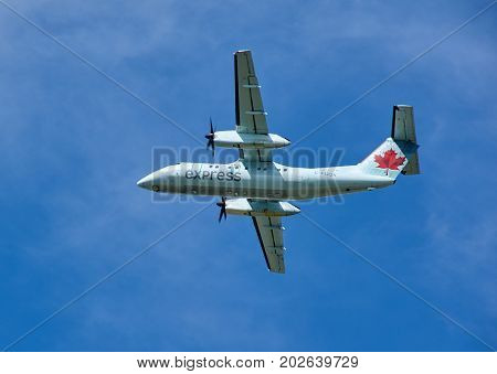 MONTREAL CANADA - AUGUST 28 2017 : Air Canada Express landing plane. Air Canada Express is a brand name under which four regional airlines operate feeder flights for Air Canada.