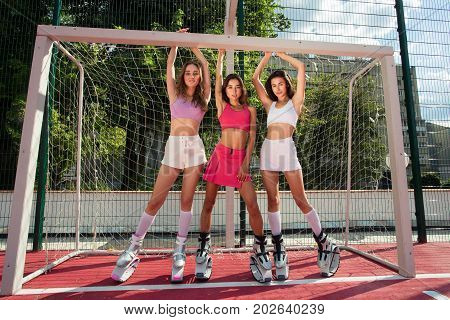Sport Girls Posed Near Football Goal In Fitness Shoes. Fitness Kangoo Outside. Sexy Young Woman Do S