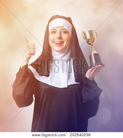 Young Smiling Nun With Golden Trophy Cup