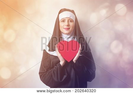 Young Smiling Nun With Heart Shape Box