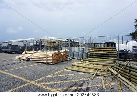 CADILLAC, MICHIGAN / UNITED STATES - JUNE 22, 2017: Lumber and various construction materials, offered for sale by Family Farm and Home, are stored in a corner of the parking lot of the Village at Wexford Shopping Center on Mitchell Street.