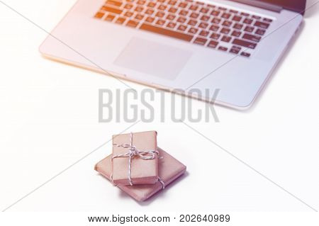 Beautiful Small Gifts And Cool Laptop On The Wonderful Pink Background
