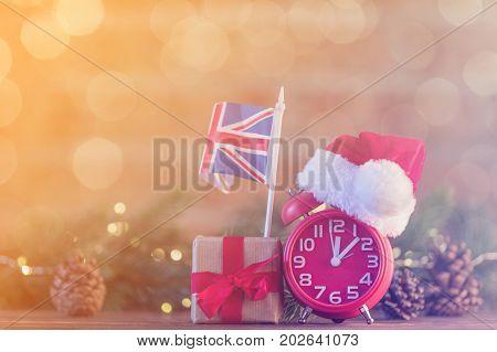 Alarm Clock With Santa Claus Hat Near United Kingdom Flag