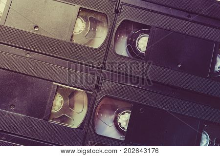 Retro video cassettes background, VHS tapes, toned