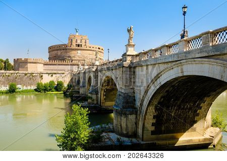 Castel Sant'Angelo and the Ponte Sant'Angelo crossing the river Tiber in Rome