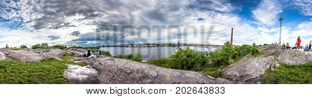 STOCKHOLM, SWEDEN - 15 JUNE 2017: Skinnarviksberget is highest natural point in central Stockholm and popular place for picnics. 360 degree Panoramic montage from 31 images