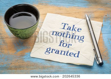 Take nothing for granted - handwriting on a napkin with a cup of tea