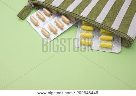 Colorful assorted pharmaceutical tablets and capsules. White beige and yellow pills. Medical conceptual photo pharmacy theme