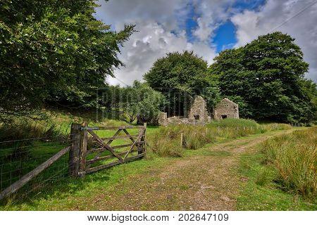 Old Tin Mine, old ruined granite buildings set on Dartmoor. UK