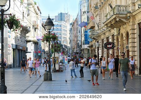 BELGRADE SERBIA - August 04: Walking street Kneza Mihaila with people walking fast in Belgrade Serbia - August 04 2017; Famous walking street with many shops and people walking around in city centre.