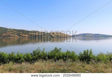 Largest European river Danube shore on Serbian - Romanian border with wide riverbed