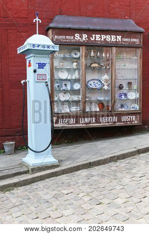 Aarhus, Denmark - August 28, 2017: Vintage store and old BP gasoline pump in the old town in Aarhus, Denmark called