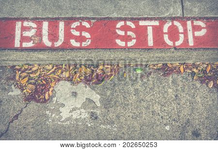 Old Bus Stop Sign On A Sidewalk In San Francisco