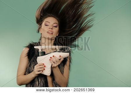 Woman With Windblown Hair Holding Ice Skate