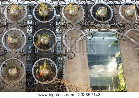 BRISBANE, AUSTRALIA - August 29, 2017: Detail of a building facade decorated with real plants in pots in Fortitude Valley Brisbane Australia