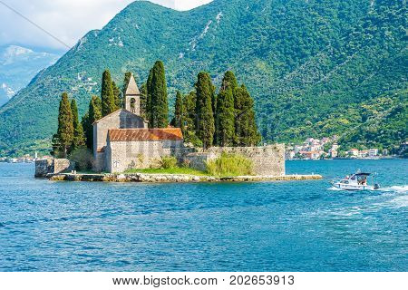 The Yacht Sails Near The Picturesque Island Of St. George In The Bay Of Kotor.