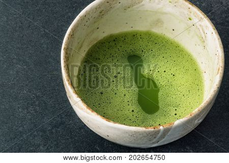 A warm cup of matcha usucha style. Matcha is made of finely ground green tea powder. It's very common in japanese culture. Matcha is healthy due to it's high antioxydant count.
