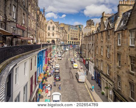 EDINBURGH, SCOTLAND - JULY 26: Famously colourful Victoria Street in the Old Town on July 26, 2017. The old town with many Reformation-era buildings is protected by UNESCO World Heritage Site.